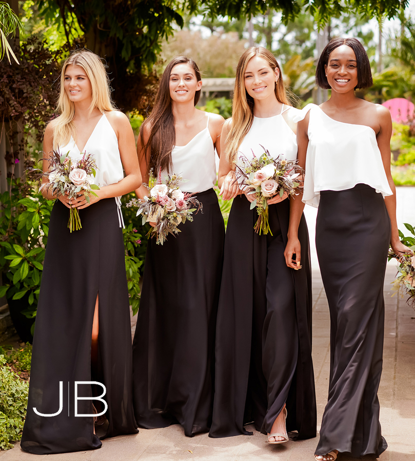Four bridesmaids wearing 2-piece black and white dresses
