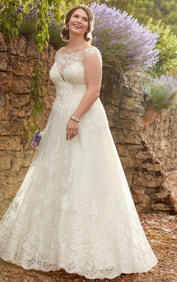 Plus-size bride wearing boho A-line wedding dress with high illusion neck