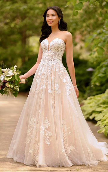 Bride wearing strapless lace ball gown wedding dress