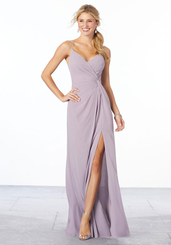 Sultry lilac chiffon Mori Lee bridesmaids dress featuring a surplice bodice with a v-shaped neckline, gathering at the waist, and a side slit