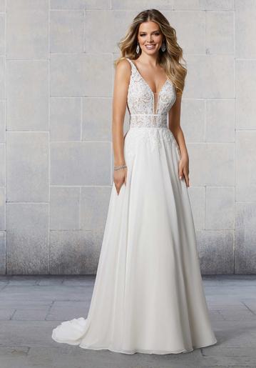 Bride wearing sleeveless A-line wedding dress with chiffon skirt