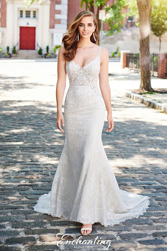 Bride walking outside. wearing lace A-line wedding dress