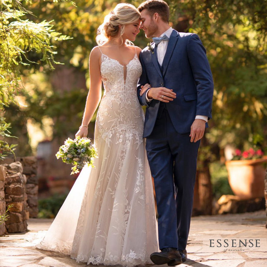 Beautiful bride wearing Essense of Austalia fit and flare bridal gown, walking with groom