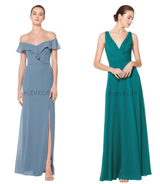 Two bridesmaids, one wearing dusty blue dress, the other wearing green dress