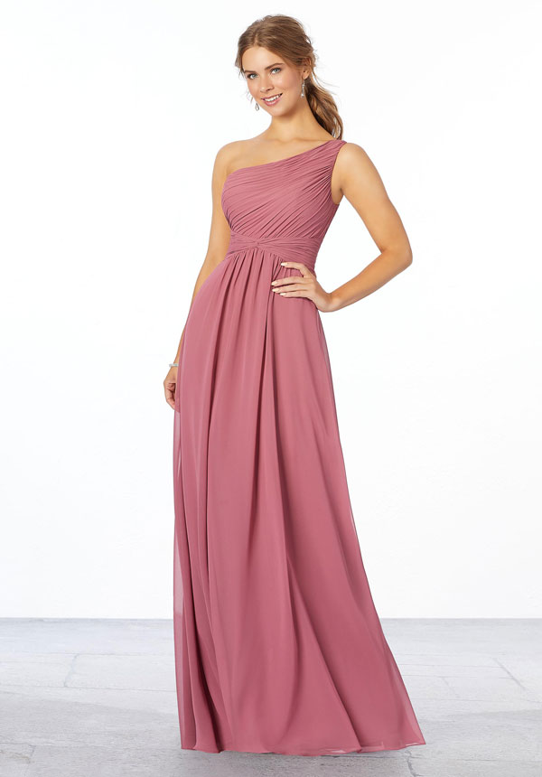 Elegant rosewood-color A-line Mori Lee bridesmaids dress with an asymmetrical neckline, pleated bodice, and ruched waistband