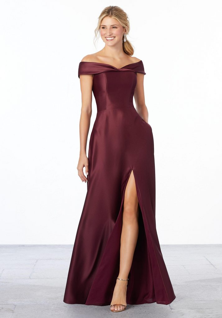 Bordeaux-color satin A-line Mori Lee bridesmaids dress featuring an off the shoulder neckline and thigh-high slit