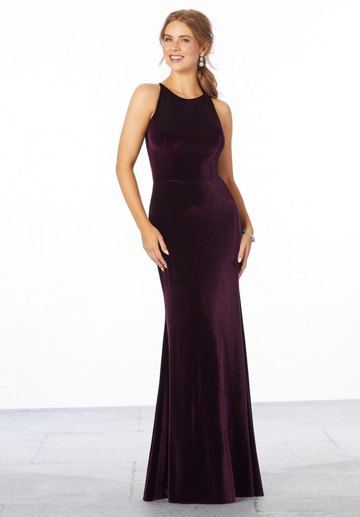 Young woman wearing stretch velvet sheath bridesmaid dress with a high neckline