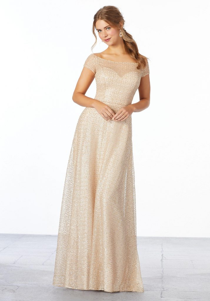 Young woman wearing elegant caviar mesh A-line bridesmaid dress with an off-the-shoulder, illusion neckline