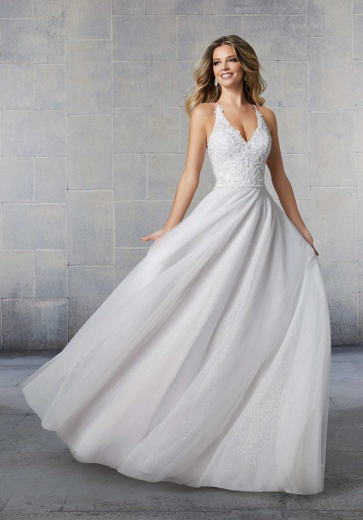 Bride wearing A-line wedding dress with halter neck