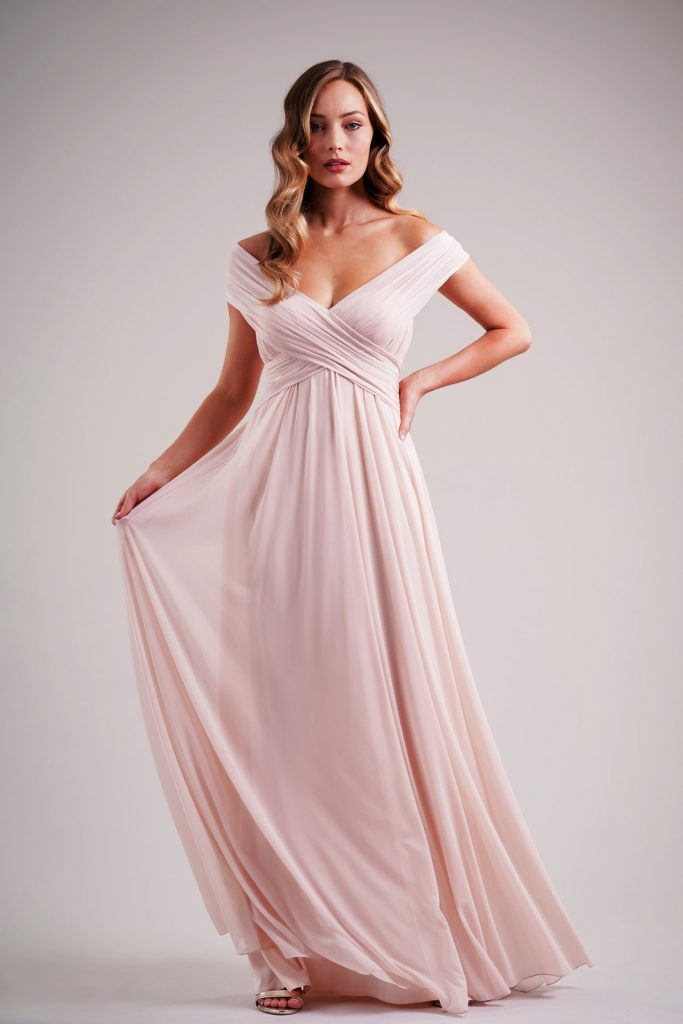 Long pink bridesmaids dress with off the shoulder cap sleeves