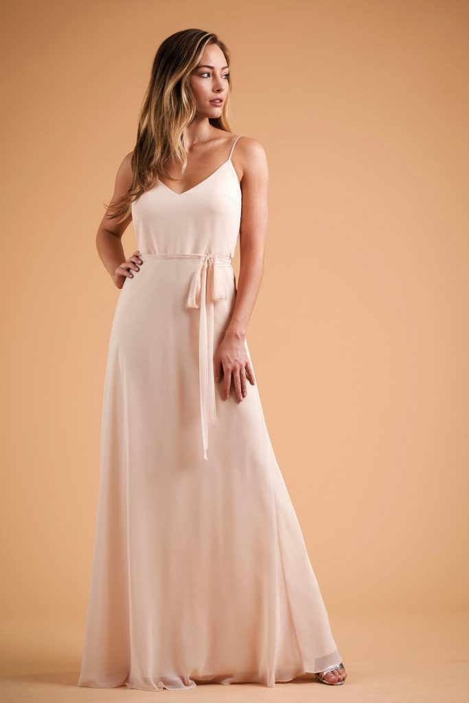 Long peach-color bridesmaids dress with spaghetti straps