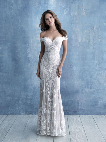 Bride wearing lace sheath wedding dress with off-the-shoulder cap sleeves
