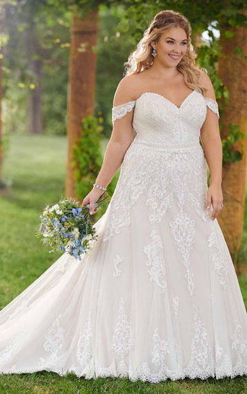 Plus-size-bride wearing A-line wedding dres with off-the-shoulder cap sleeves