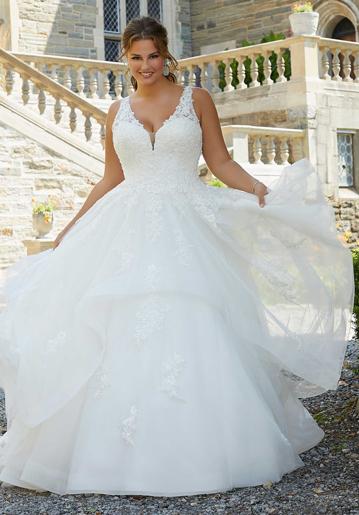 Plus-size bride wearing beautiful sleeveless ball gown wedding dress