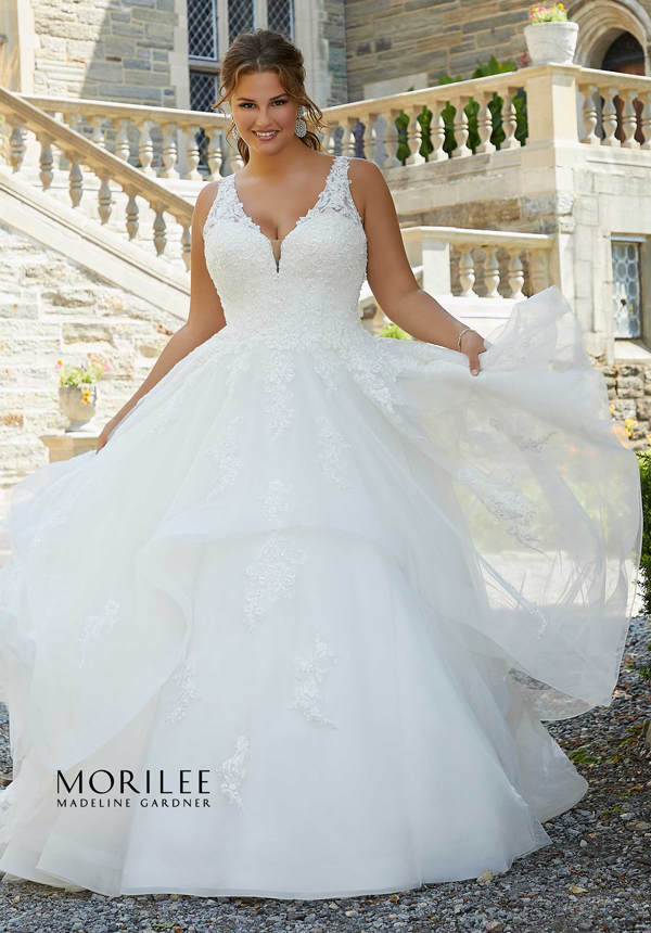 Bride wearing beautiful ballgown wedding dress with tiered skirt