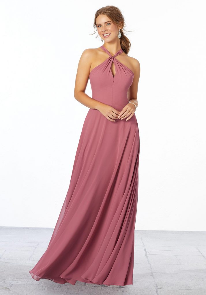 Young woman wearing rosewood A-line bridesmaid dress with a keyhole front, wrap-around neckline, and keyhole back.