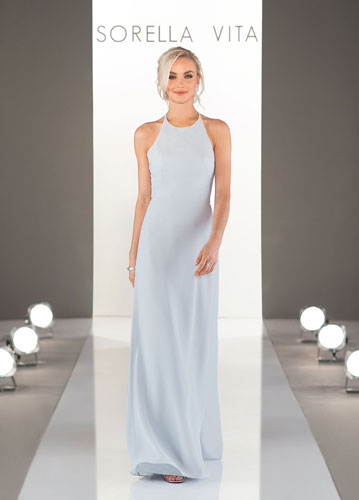 Model on runway wearing pale blue long formal dress with halter neck