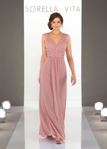 Model on runway wearing long rose-colored formal dress with V-neck