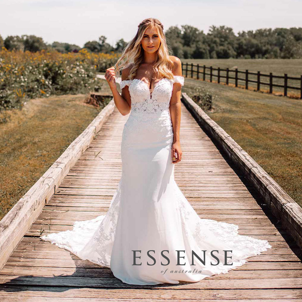 Classic off-the-shoulder sheath wedding dress by Essense of Australia