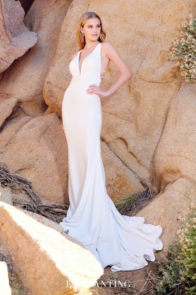 Sleeveless sheath bridal gown with halter neck