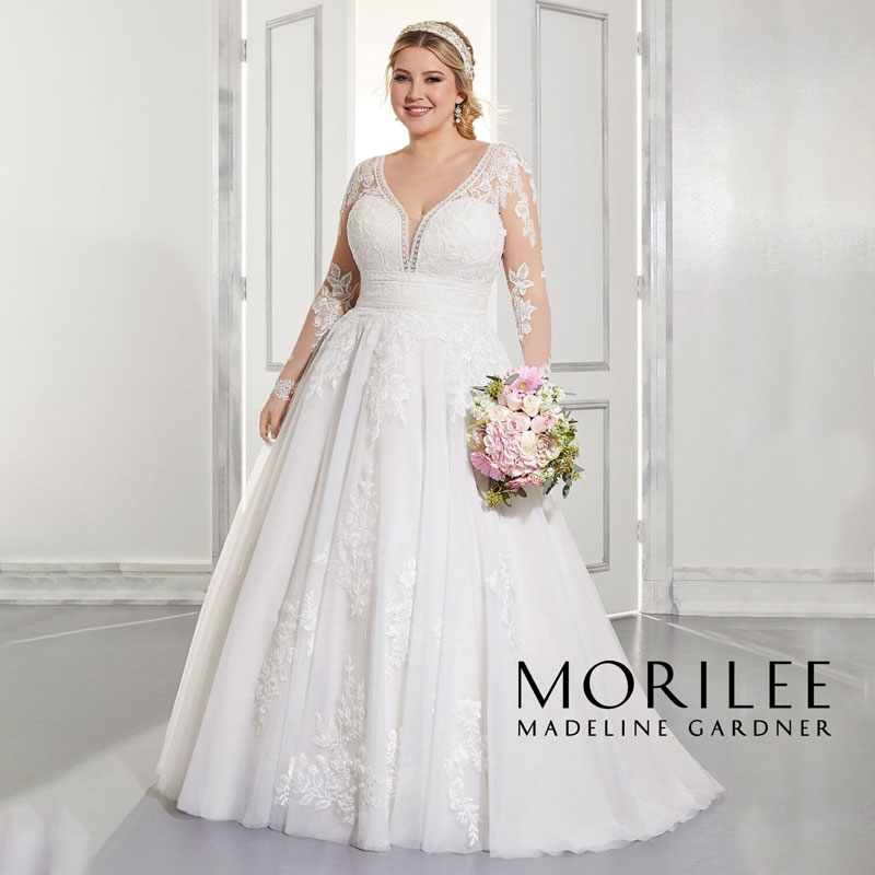 Plus-size A-line wedding dress with long lace sleeves from Morilee by Madeline Gardner