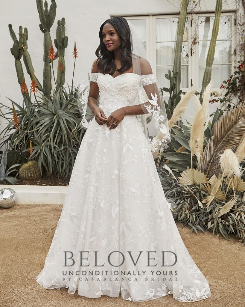 Classic off-the-shoulder A-line wedding dress with veil