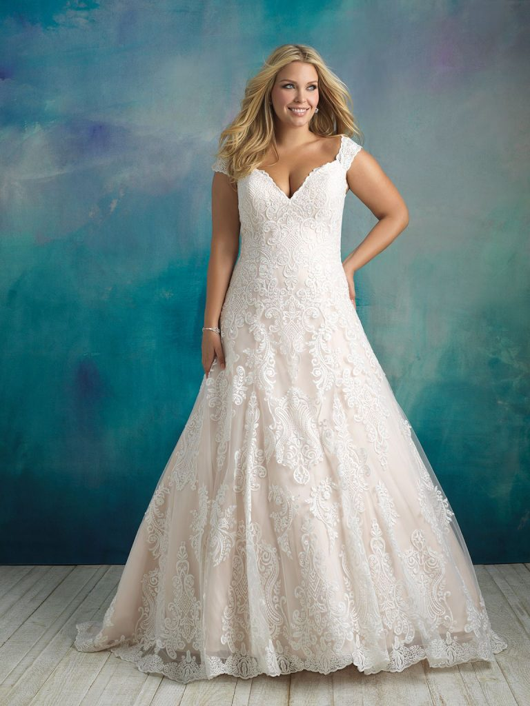Plus-size A-line wedding dress with cap sleeves by Allure Bridals