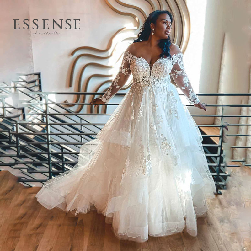 Plus-Size ballgown wedding dress with long lace sleeve, from Essense of Australis
