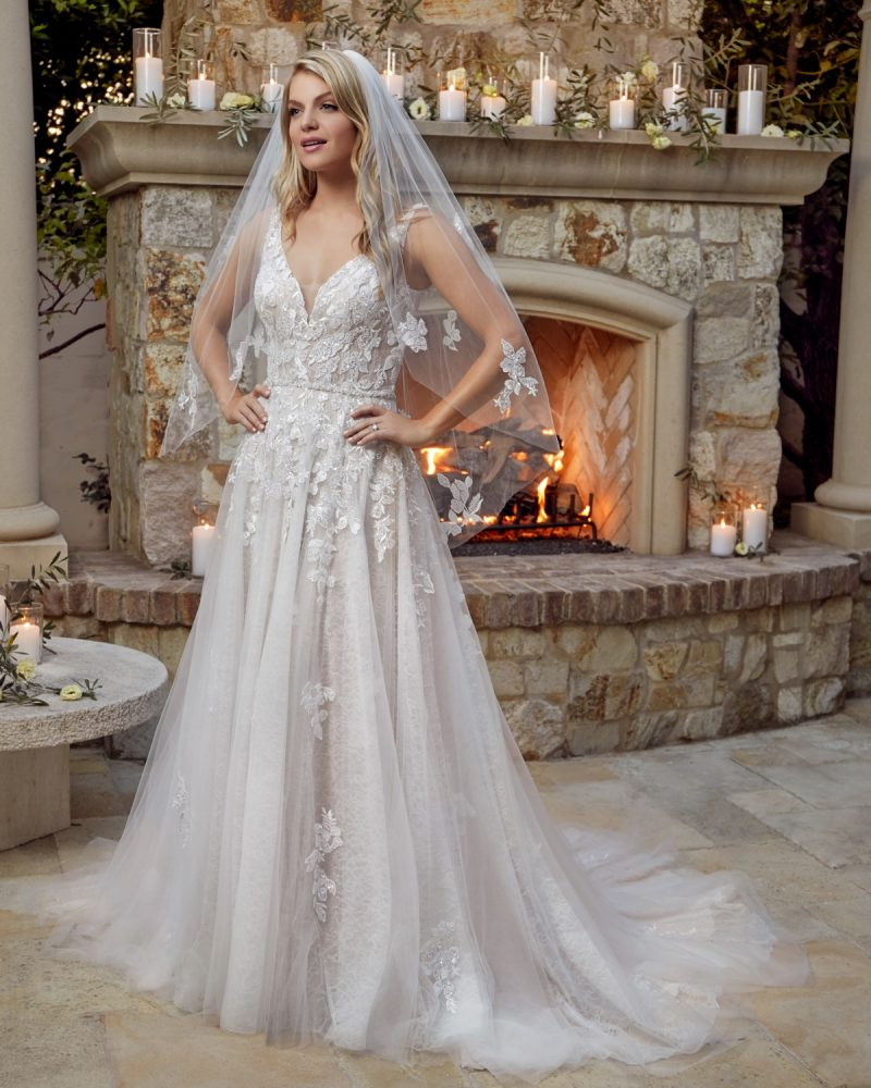Classic sleeveless A-line bridal gown with veil