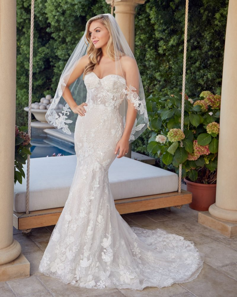 Strapless fit and flare bridal gown with veil