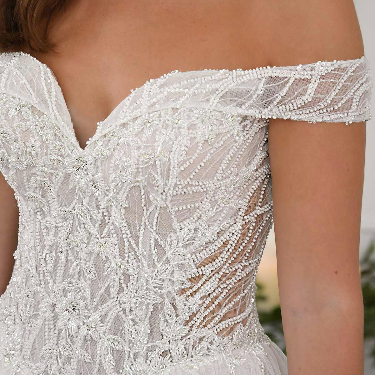 Graphic lace and dazzling beadwork on the bodice of this ballgown wedding dress