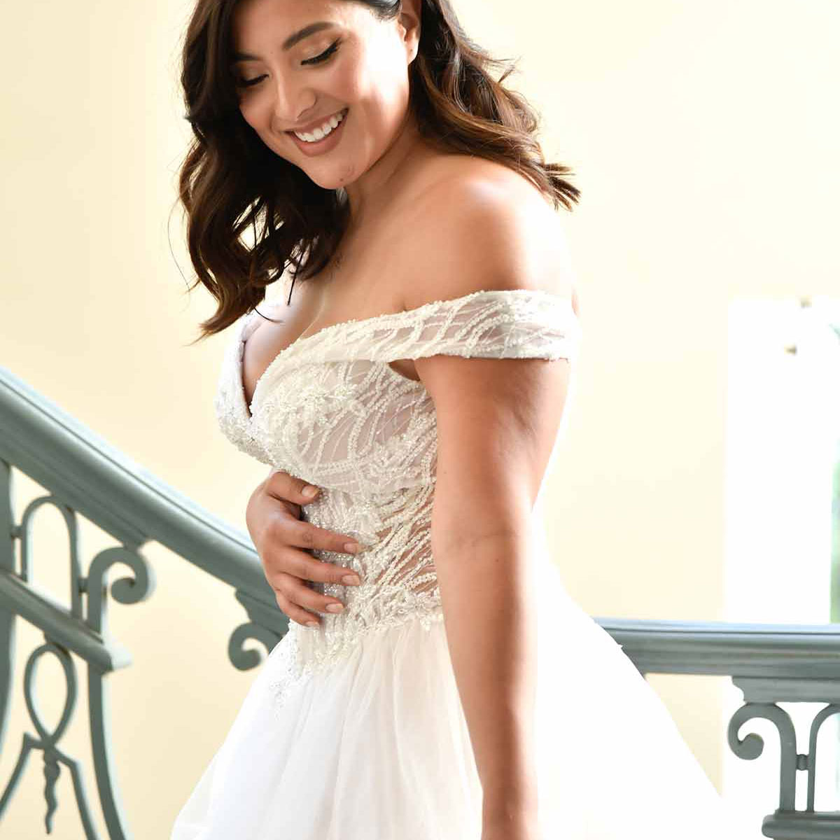 Off-the-shoulder cap sleeves on this ballgown wedding dress