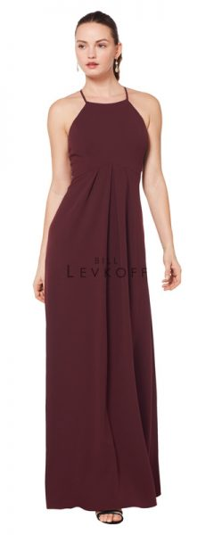 Young woman wearing burgundy bridesmaids dress with halter neck