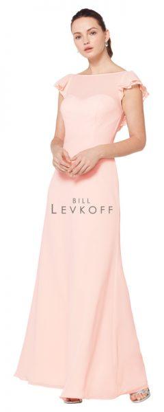 Young woman wearing long peach bridesmaids dress