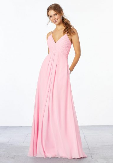 Young woman wearing blossom-color chiffon A-line bridesmaid dress with a pleated v-neck bodice