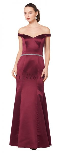 Young woman wearing cabernet satin bridesmaids dress with off the shoulder cap sleeves and cute sparkly belt
